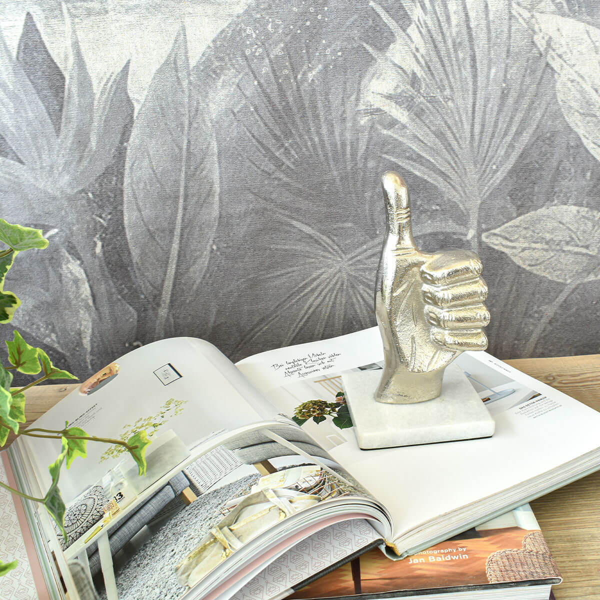 thumbs-up-decor-on-marble-base