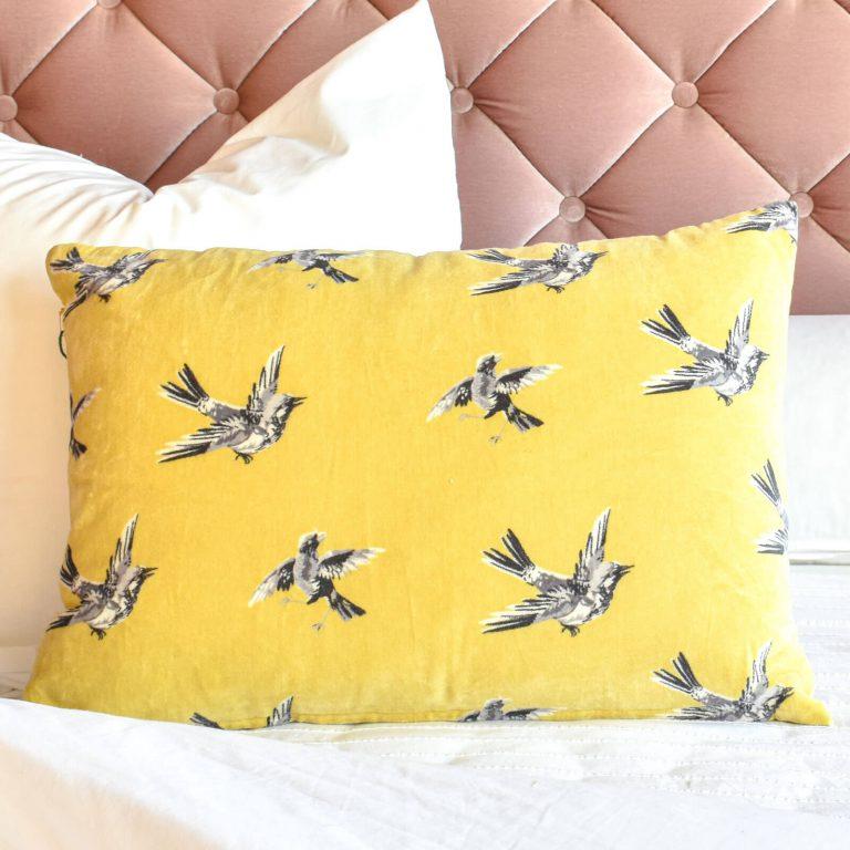 Swinging Bird Ochre Cushion